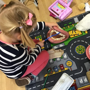 Girl playing on the mat