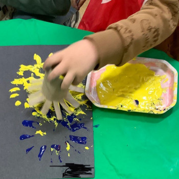 One of the children making a firework painting