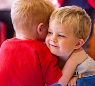 Two children sharing a hug