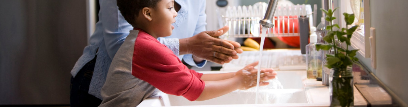 Mother and child washing hands