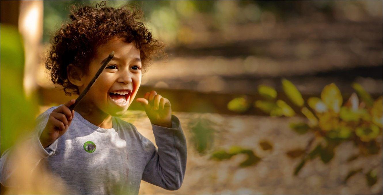 A boy running through the forest