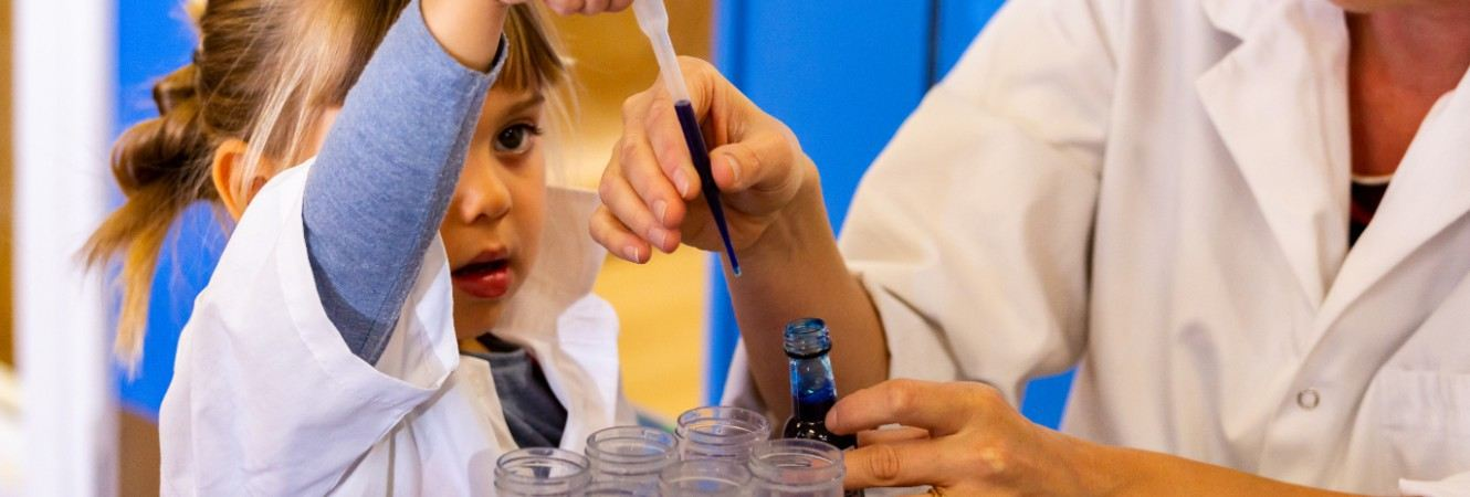 A teacher and child doing a science experiment