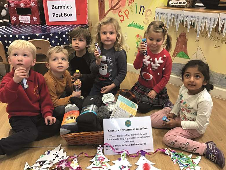 The children with coins and money raised.